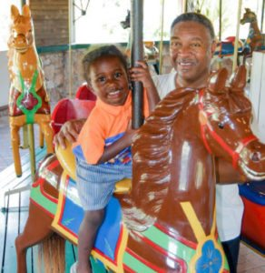 Father and son at the carousel