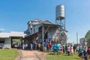 crowd of people around cotton gin museum