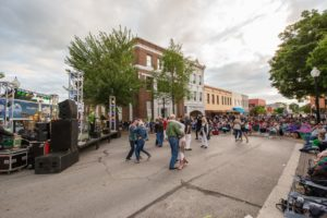 band performing in downtown brenham people dancing in the street