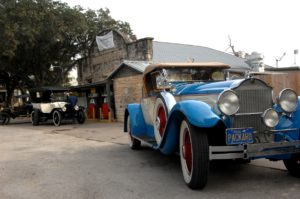 classic cars at old fuel station