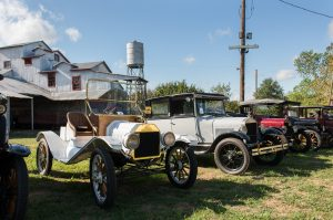 Model T's in front of Cotton Gin